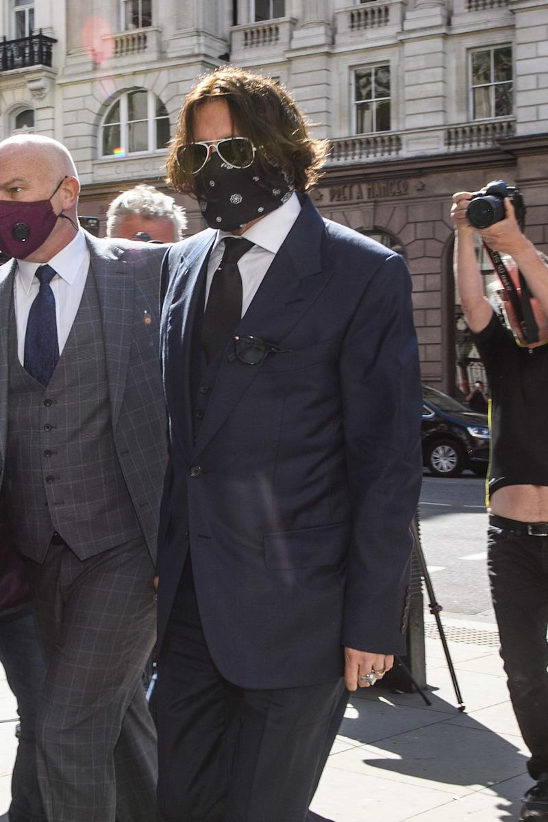 Both Depp and Heard wore face covering as they arrived in court (Photo: Empics Entertainment)