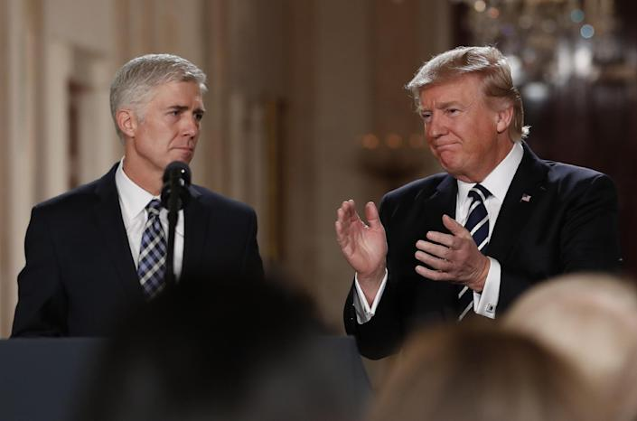 In this Jan. 31, 2017, photo, President Donald Trump applauds as he stands with Judge Neil Gorsuch in East Room of the White House in Washington, after announcing Gorsuch as his nominee for the Supreme Court. Two weeks into his presidency, Donald Trump has thrown Washington into a state of anxious uncertainty. Policy pronouncements sprout up from the White House in rapid succession. Some have far-reaching implications, most notably Trump's temporary refugee and immigration ban, but others disappear without explanation, including planned executive actions on cybersecurity and the president's demand for an investigation into unsubstantiated voter fraud. The day's agenda can quickly be overtaken by presidential tweets, which often start flashing on smartphones just as the nation's capital is waking up. (AP Photo/Carolyn Kaster)