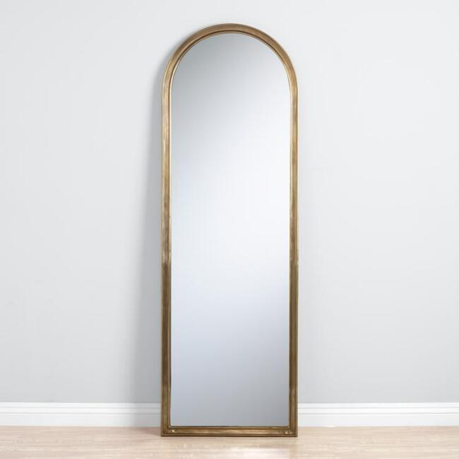 <p>I hunted for a sturdy, full-length mirror that wasn't horrifyingly expensive and landed on this <span>Arched Gold Mirror</span> ($250) from World Market. Fun fact: World Market is full of hidden furnishing gems!</p>