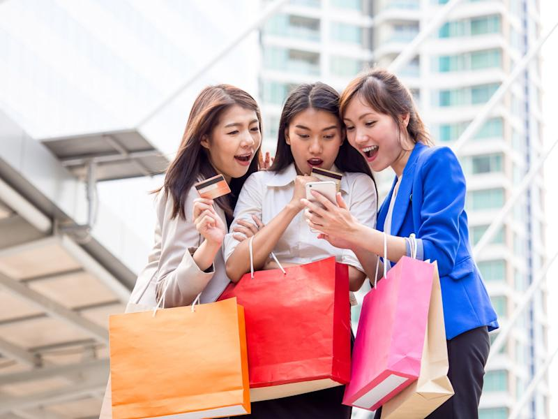 people shopping with prepaid credit cards