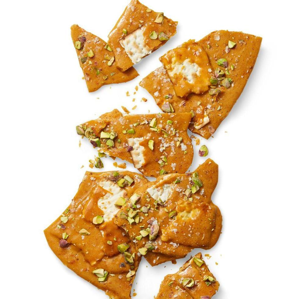"""<p>Matzo coated in caramel, orange zest and pistachios will make you fall in love with the flatbread.</p><p><em><a href=""""https://www.womansday.com/food-recipes/food-drinks/a26678273/matzo-brittle-recipe/"""" rel=""""nofollow noopener"""" target=""""_blank"""" data-ylk=""""slk:Get the recipe for Matzo Brittle »"""" class=""""link rapid-noclick-resp"""">Get the recipe for Matzo Brittle »</a></em></p>"""