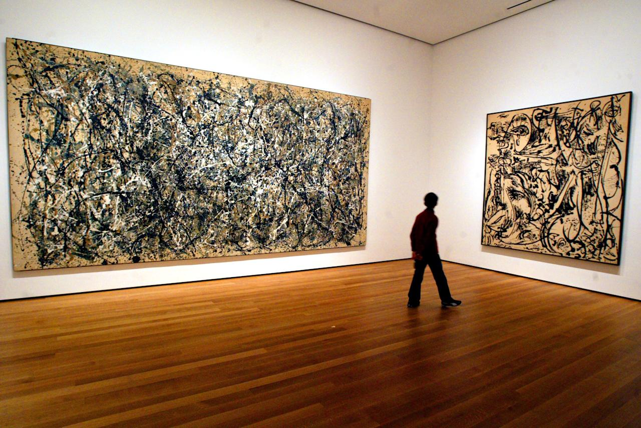 FILE - In this April, 13, 2005 file photo, a visitor strolls by canvasses by Abstract Expressionist Jackson Pollock at the Museum of Modern Art in New York. Pollock, who would have turned 100 in 2012, will have the anniversary of his birth observed with exhibitions, fundraisers and other events throughout the year. (AP Photo/Mary Altaffer, File)