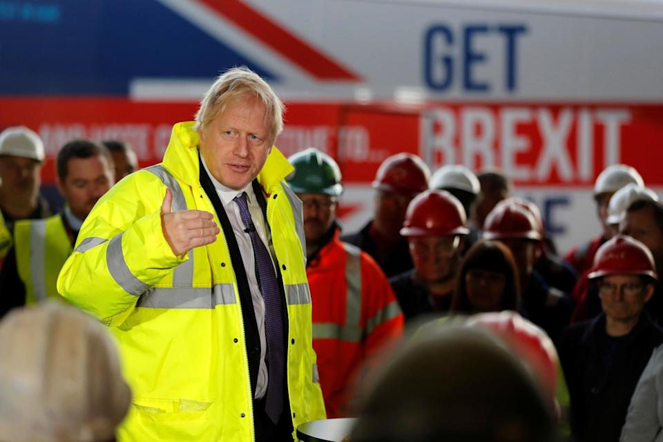 Boris Johnson speaks to workers during a visit to Wilton Engineering Services: REUTERS