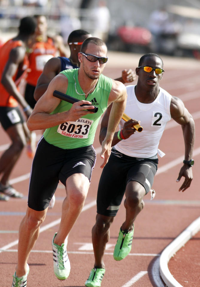 Team Adidas' Jeremy Wariner (6033) takes off on the anchor leg of the men's invitational 4x400 meter relay race at the Texas Relays athletics meet in Austin, Texas on Saturday, April 9, 2011.