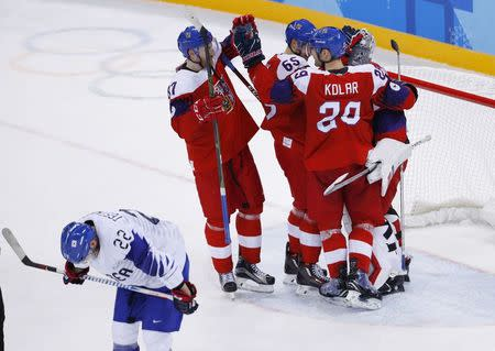 Ice Hockey – Pyeongchang 2018 Winter Olympics – Men Preliminary Round Match – Czech Republic v South Korea - Gangneung Hockey Centre, Gangneung, South Korea – February 15, 2018 - Players from the Czech Republic celebrate after the game as Mike Testwuide of South Korea skates by. REUTERS/Brian Snyder
