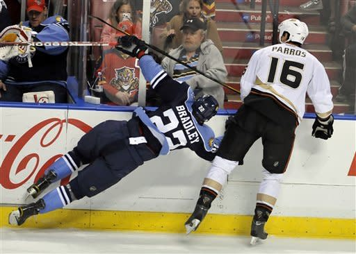 Anaheim Ducks' George Parros (16) collides with Florida Panthers' Matt Bradley (22) during the second period of an NHL hockey game, Sunday, Feb. 19, 2012, in Sunrise, Fla. (AP Photo/Gary I Rothstein)