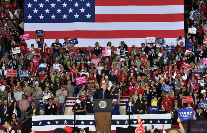 President Donald Trump speaks to a cheering crowd at Eastern Kentucky University, Saturday, Oct. 13, 2018, in Richmond, Ky. (AP Photo/Timothy D. Easley)