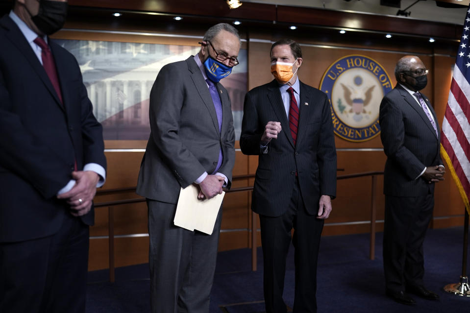 Senate Majority Leader Chuck Schumer, D-N.Y., left, and Sen. Richard Blumenthal, D-Conn., attend a news conference on passage of gun violence prevention legislation, at the Capitol in Washington, Thursday, March 11, 2021. (AP Photo/J. Scott Applewhite)