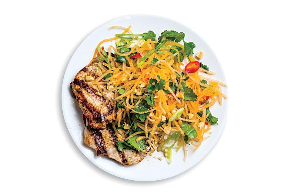"""This grilled pork recipe is the one to have on hand when summer melons really start smelling great. You'll shred the cantaloupe on a grater, then toss with scallions, cilantro, fish sauce, and lime for a refreshing salad. Crunchy peanuts finish the dish. <a href=""""https://www.epicurious.com/recipes/food/views/pork-cutlets-with-cantaloupe-salad?mbid=synd_yahoo_rss"""" rel=""""nofollow noopener"""" target=""""_blank"""" data-ylk=""""slk:See recipe."""" class=""""link rapid-noclick-resp"""">See recipe.</a>"""