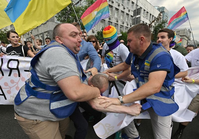 More than 8,000 people turned out for Kiev's Gay Pride march amid tight security as far-right activists sought to disrupt the celebration (AFP Photo/Genya SAVILOV)
