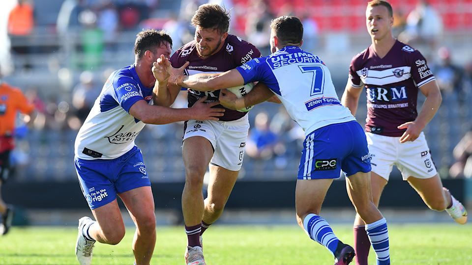 Manly and the Bulldogs, pictured here in action during round 24 of the NRL.