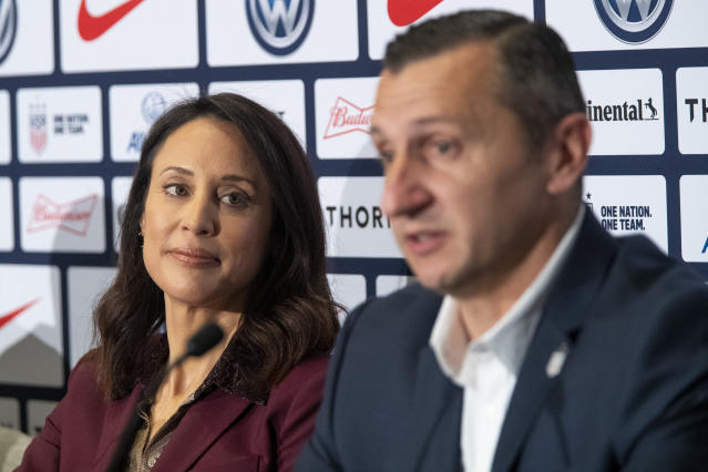 Kate Markgraf, left, general manager of the U.S. women's national soccer team, listens as Vlatko Andonovski speaks during a news conference Monday, Oct. 28, 2019, in New York. U.S. Soccer president Carlos Cordeiro named Andonovski as head coach in U.S. Women's National Team on Monday. (AP Photo/Mary Altaffer)