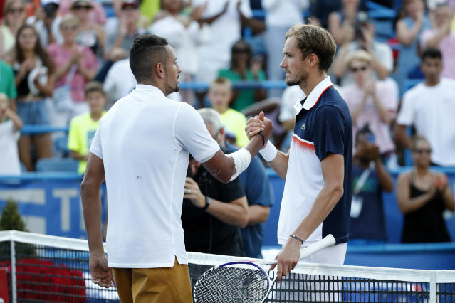 Nick Kyrgios, left, of Australia, speaks with Daniil Medvedev, of Russia, after defeating him in a final match at the Citi Open tennis tournament, Sunday, Aug. 4, 2019, in Washington. (AP Photo/Patrick Semansky)