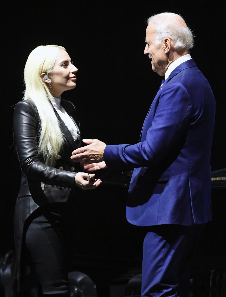 Lady Gaga (L) is greeted by Joe Biden after she performed for students as part of the national It's On Us Week of Action at the Cox Pavilion at UNLV on April 7, 2016 in Las Vegas, Nevada.  (Photo by Ethan Miller/Getty Images)