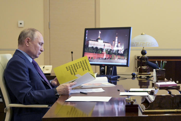 Russian President Vladimir Putin attends a meeting via video conference at the Novo-Ogaryovo residence outside Moscow, Russia, Thursday, April 15, 2021. (Alexei Druzhinin, Sputnik, Kremlin Pool Photo via AP)