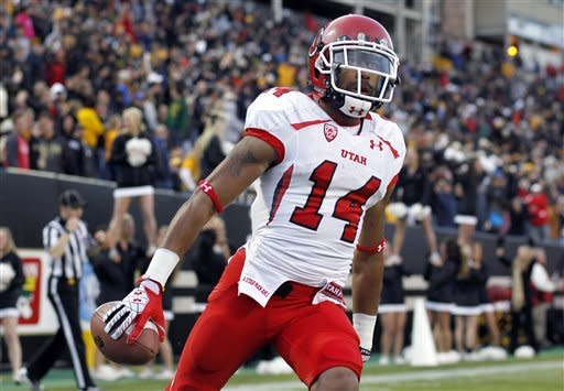 Utah kick returner Reggie Dunn celebrates his return of a kickoff for a touchdown against Colorado during the fourth quarter of Utah's 42-35 victory in an NCAA college football game in Boulder, Colo., on Friday, Nov. 23, 2012. (AP Photo/David Zalubowski)