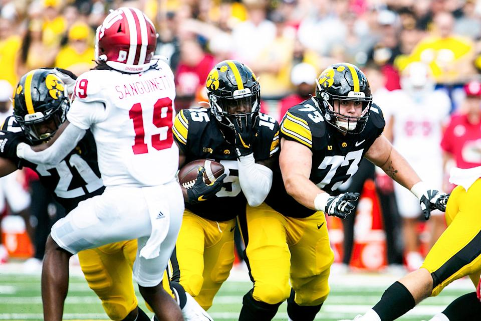 Iowa running back Tyler Goodson (15) rushes as Iowa offensive lineman Cody Ince (73) blocks during a NCAA Big Ten Conference football game against Indiana, Saturday, Sept. 4, 2021, at Kinnick Stadium in Iowa City, Iowa.