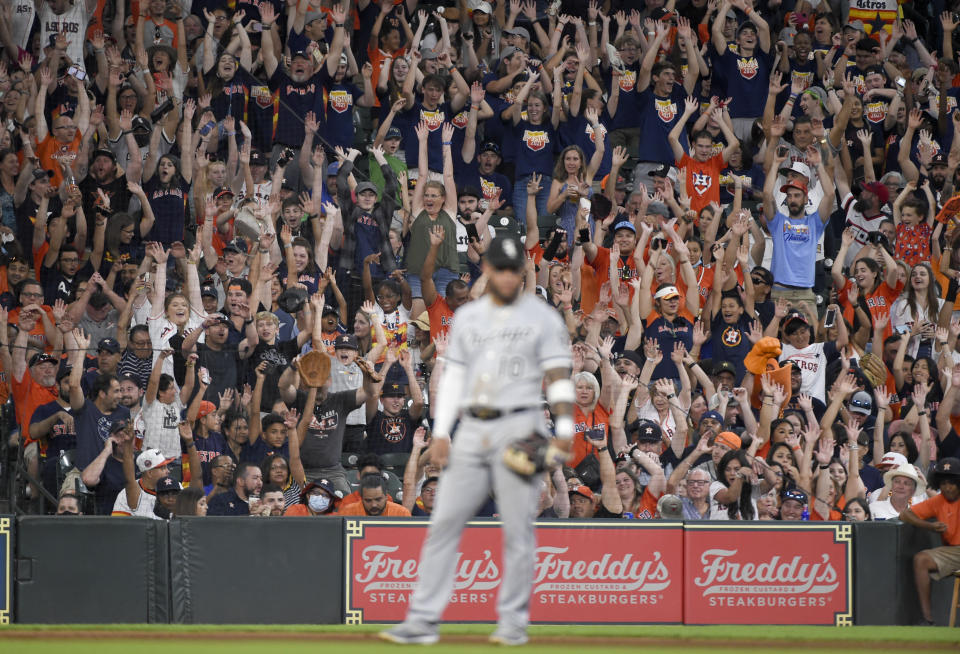 Fans do the wave during the third inning of a baseball game between the Houston Astros and the Chicago White Sox, Saturday, June 19, 2021, in Houston. (AP Photo/Eric Christian Smith)