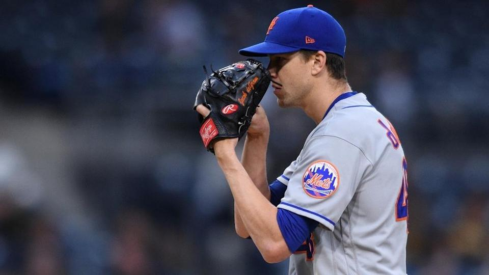 Mets Jacob deGrom glove over mouth close up Padres