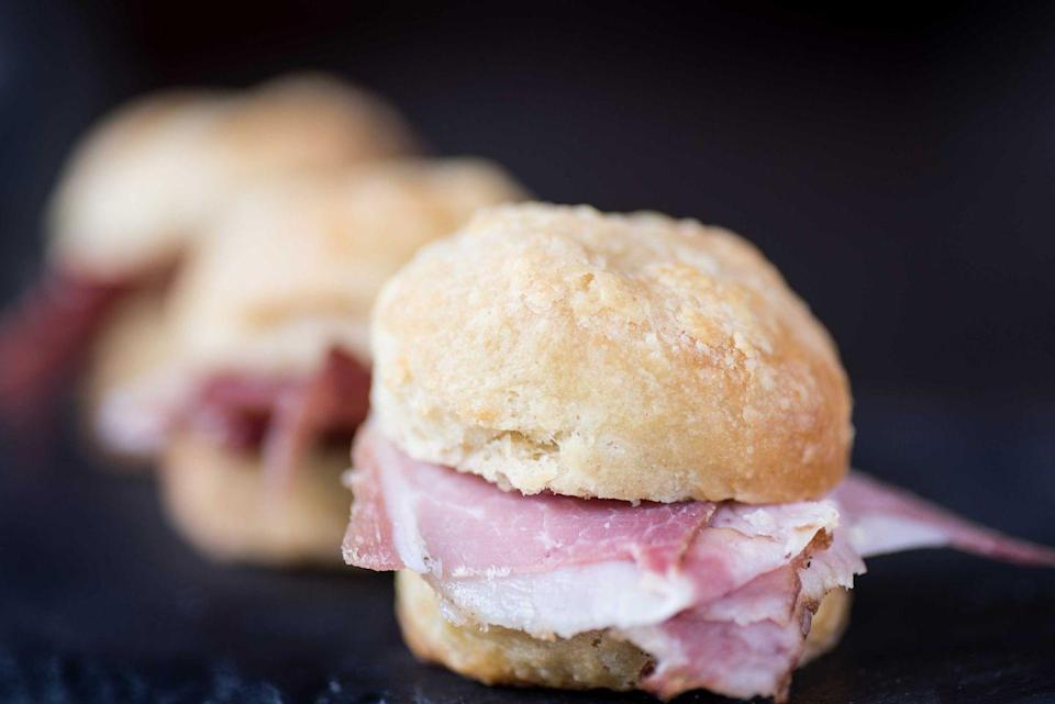 """<p><strong>Country Ham Biscuit</strong></p><p>Virginia is rightfully the birthplace of this southern charm. Created in Smithfield, the Country Ham Biscuit, country ham, a fluffy biscuit and honey mustard. It's been commercialized since where it's even on the McDonald's breakfast menu. Enjoy one at <a href=""""http://www.scratchbiscuit.com/"""" rel=""""nofollow noopener"""" target=""""_blank"""" data-ylk=""""slk:Scratch Biscuit Company"""" class=""""link rapid-noclick-resp"""">Scratch Biscuit Company</a>. </p>"""