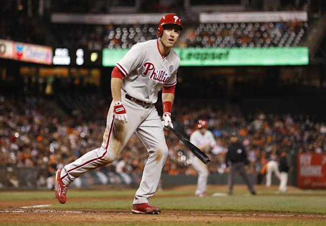 Philadelphia Phillies' Chase Utley takes his base after San Francisco Giants pitcher Javier Lopez hit Utley with a pitch, forcing a run scored as the bases were loaded during the tenth inning of a baseball game, Friday, Aug. 15, 2014, in San Francisco. (AP Photo/Beck Diefenbach)