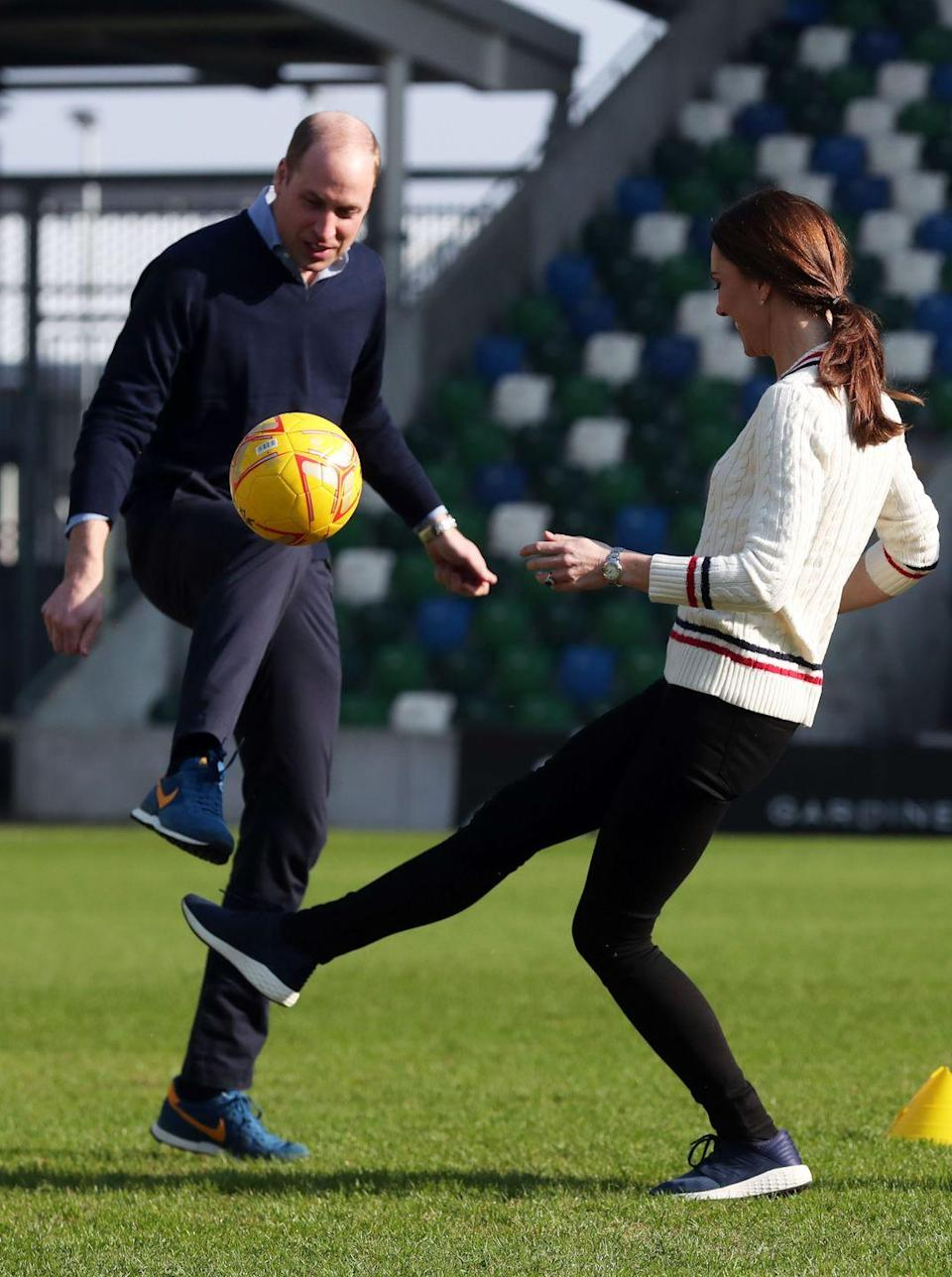 <p>The sporty couple enjoyed a game of football during their visit to the National Stadium in Belfast, February 2019. </p>
