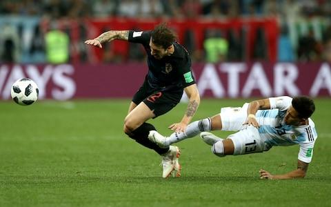 Maximiliano Meza flies into Sime Vrsaljko - Credit: Jan Kruger/Getty Images