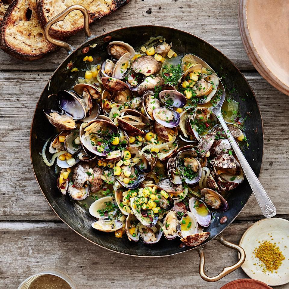 "If some of the clams have opened when you lift the lid to stir them, pluck those clams out and transfer them to a bowl while the others finish cooking, then combine them at the end. This recipe is by Kelly Mariani from <a href=""https://scribewinery.com/"" rel=""nofollow noopener"" target=""_blank"" data-ylk=""slk:Scribe Winery"" class=""link rapid-noclick-resp"">Scribe Winery</a> in Sonoma, CA. <a href=""https://www.bonappetit.com/recipe/brothy-steamed-clams-with-corn?mbid=synd_yahoo_rss"" rel=""nofollow noopener"" target=""_blank"" data-ylk=""slk:See recipe."" class=""link rapid-noclick-resp"">See recipe.</a>"