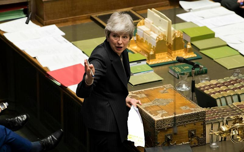 Prime Minister Theresa May speaks during Prime Minister's Questions in the House of Commons - UK Parliament/Mark Duffy