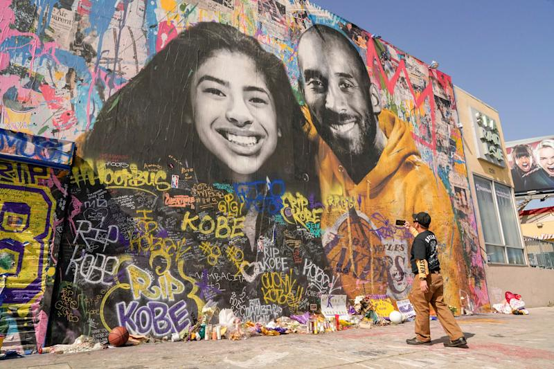 Fans gather around a mural of late NBA great Kobe Bryant and his daughter Gianna Bryant during a public memorial for them and seven others killed in a helicopter crash, at the Staples Center in Los Angeles, California, U.S., February 24, 2020. REUTERS/Kyle Grillot