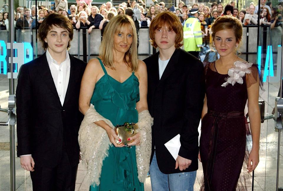 Author JK Rowling (centre left) with stars of the film Daniel Radcliffe (far left), Rupert Grint and Emma Watson arrive for the UK premiere of Harry Potter And The Prisoner of Azkaban at the Odeon Leicester Square in Central London, the third film from author JK Rowling's series of books on the boy wizard.   (Photo by Ian West - PA Images/PA Images via Getty Images)