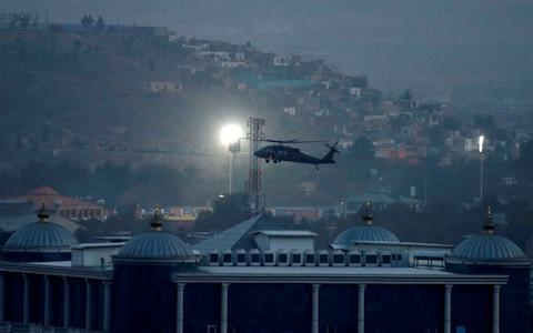 A NATO helicopter lands at the Resolute Support headquarters in Kabul, Afghanistan - Credit: MOHAMMAD ISMAIL/REUTERS