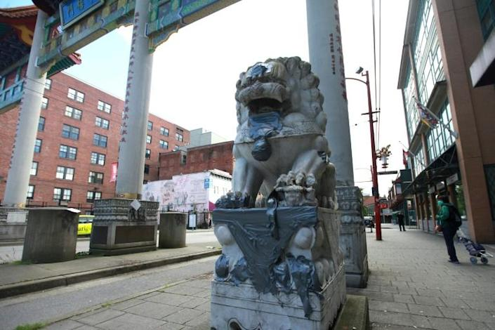 A statue is seen at the gates of Chinatown, as Vancouver police are investigating a sevenfold spike in anti-Asian incidents over the same three months in 2019, including anti-Chinese, coronavirus-related graffiti (AFP Photo/David P. BALL)