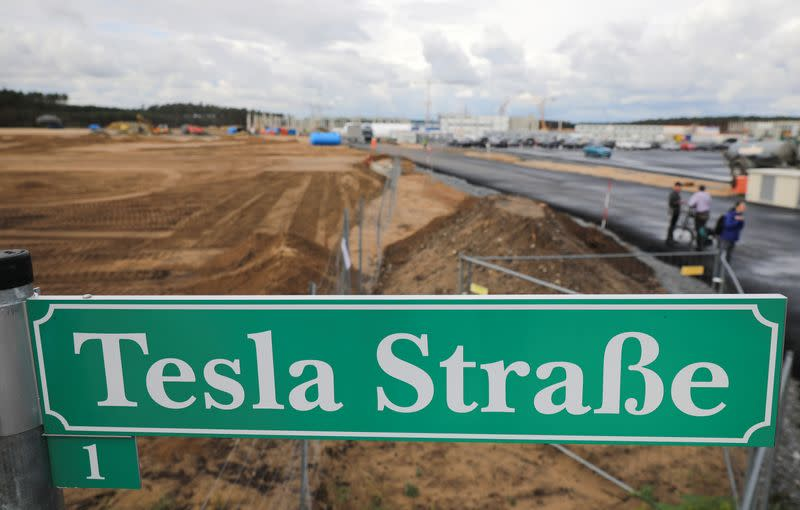 """FILE PHOTO: A sign that reads """"Tesla Street"""" is pictured outside the construction site of the future Tesla Gigafactory, in Gruenheide"""
