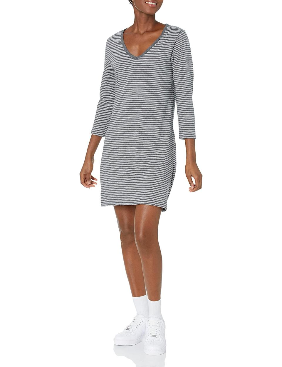 """<h2>T-Shirt Dresses</h2><br>Comfort is key with a t-shirt dress made for unrestricted movement and endless versatility. <br><br><strong>Daily Ritual</strong> Cotton 3/4-Sleeve V-Neck Dress, $, available at <a href=""""https://amzn.to/3Amb7cy"""" rel=""""nofollow noopener"""" target=""""_blank"""" data-ylk=""""slk:Amazon"""" class=""""link rapid-noclick-resp"""">Amazon</a>"""