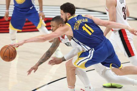 May 20, 2019; Portland, OR, USA; Golden State Warriors guard Klay Thompson (11) reaches for the ball against Portland Trail Blazers guard Damian Lillard (0) in the second half of game four of the Western conference finals of the 2019 NBA Playoffs at Moda Center. Mandatory Credit: Jaime Valdez-USA TODAY Sports
