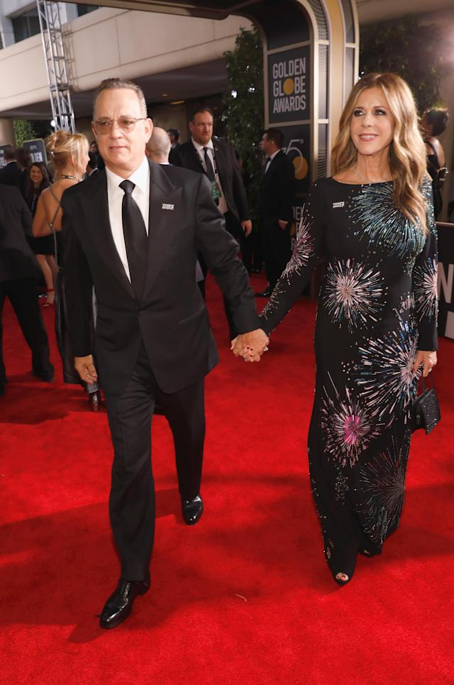 "A martini for Rita Wilson? Tom Hanks brought a tray of drinks back to his crew, including his longtime ""plus one,"" wife Rita Wilson. (Photo: Getty Images)"