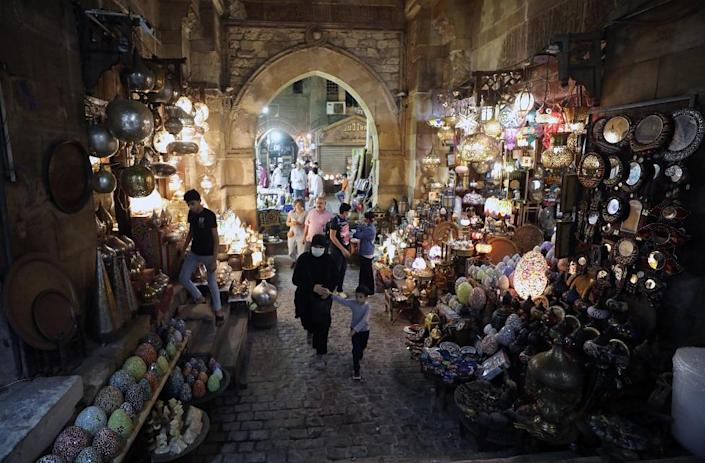 People walk in Khan al-Khalili bazaar in old Cairo, Egypt, 27 September 2021, as the world marks the United Nations (UN) World Tourism Day.