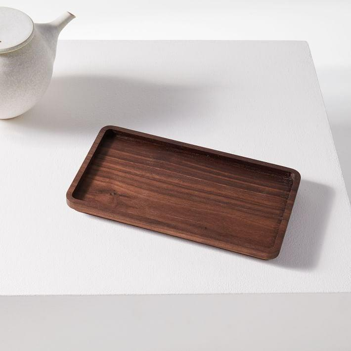 <p>You'll always have use for this <span>Holler Design Wood Coffee Tray</span> ($30).</p>