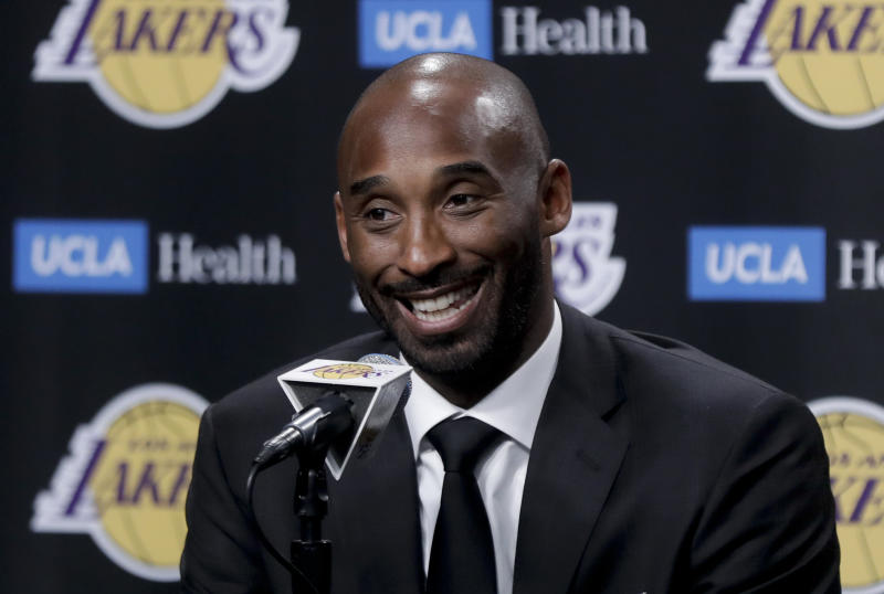 FILE - In this Dc. 18, 2017 file photo, former Los Angeles Laker Kobe Bryant talks during a news conference in Los Angeles. Bryant and fellow NBA greats Tim Duncan and Kevin Garnett headlined a nine-person group announced Saturday, April 4, 2020, as this years class of enshrinees into the Naismith Memorial Basketball Hall of Fame. They all got into the Hall in their first year of eligibility, as did WNBA great Tamika Catchings. Two-time NBA champion coach Rudy Tomjanovich, longtime Baylor womens coach Kim Mulkey, 1,000-game winner Barbara Stevens of Bentley and three-time Final Four coach Eddie Sutton were selected. So was former FIBA Secretary General Patrick Baumann. (AP Photo/Chris Carlson, File)