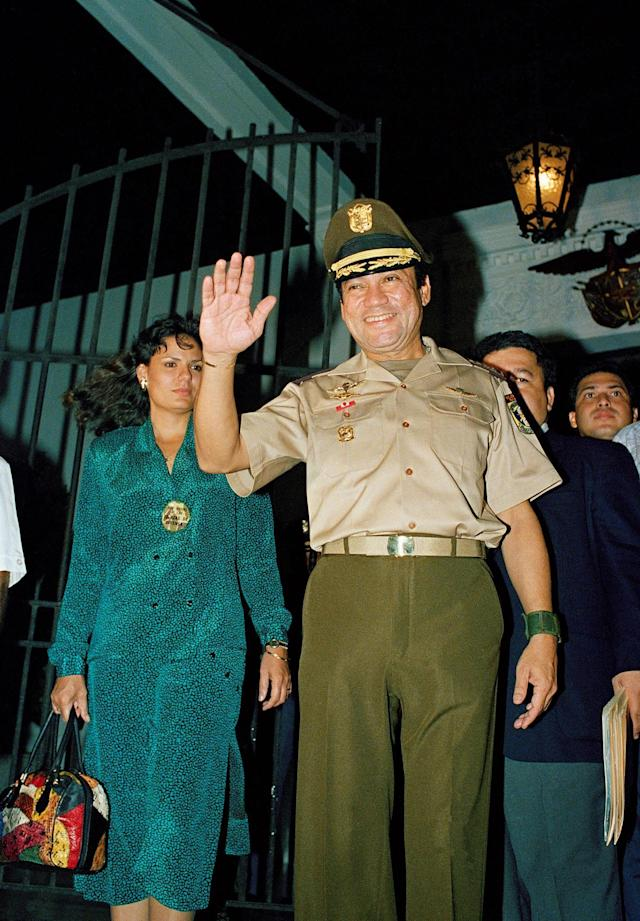 <p>Military strongman Gen. Manuel Antonio Noriega waving to supporters outside the presidential palace in Panama City on March 22, 1988. (AP Photo/John Hopper) </p>