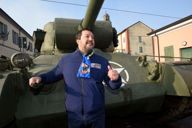 League's leader Matteo Salvini poses next to a tank that was used in an old fiction movie during an electoral rally, in Brescello, central Italy, Sunday, Jan. 12, 2020. (Stefano Cavicchi/LaPresse via AP)