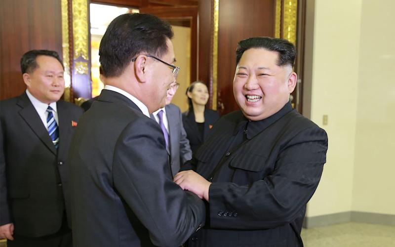 North Korean leader Kim Jong-Un shaking hands with South Korean chief delegator Chung Eui-yong, who travelled as envoys of the South's President Moon Jae-in, during their meeting in Pyongyang. - AFP