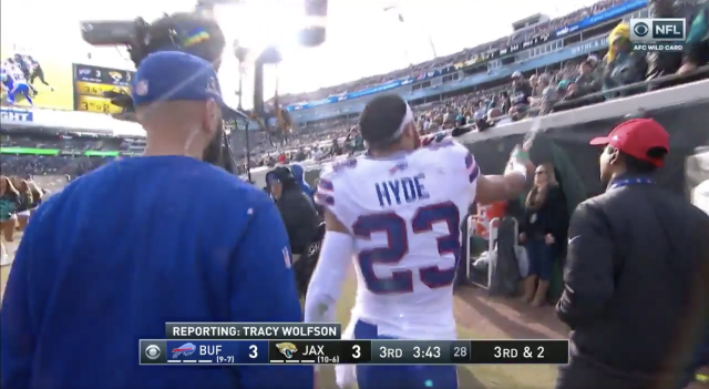 Micah Hyde sprayed some water on a fan as he left the field Sunday. (Twitter.com/TheRenderNFL screen shot)