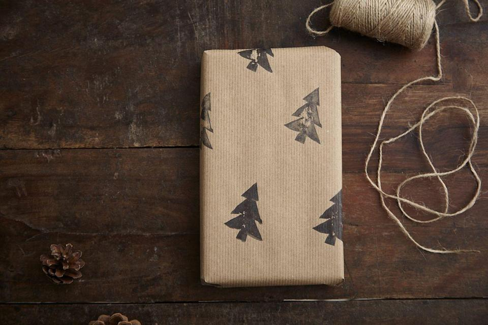 """<p>Whether you use store-bought stamps or carve seasonal shapes from potatoes, one thing is for sure: it's an easy DIY to turn plain paper into gift wrap. </p><p><a class=""""link rapid-noclick-resp"""" href=""""https://www.amazon.com/Holiday-Stamps-Stampmojis-Jumbo-Rubber/dp/B07NVGSJB3?tag=syn-yahoo-20&ascsubtag=%5Bartid%7C10072.g.34015639%5Bsrc%7Cyahoo-us"""" rel=""""nofollow noopener"""" target=""""_blank"""" data-ylk=""""slk:SHOP HOLIDAY STAMPS"""">SHOP HOLIDAY STAMPS</a></p>"""