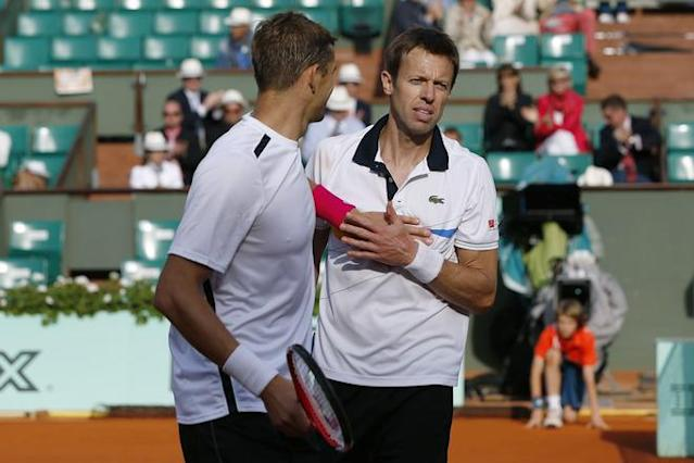 Belarus Max Mirnyi (L) and Canada's Daniel Nestor react after wining over US Bob Bryan and US Mike Bryan during Men's Doubles final tennis match of the French Open tennis tournament at the Roland Garros stadium, on June 9, 2012 in Paris. AFP PHOTO / THOMAS COEXTHOMAS COEX/AFP/GettyImages