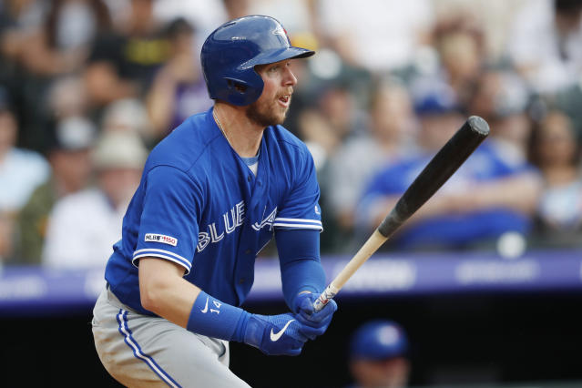 FILE - In this June 2, 2019, file photo, Toronto Blue Jays' Justin Smoak follows the flight of his single off Colorado Rockies starting pitcher Antonio Senzatela during the third inning of a baseball game in Denver. The Colorado Rockies finalized a one-year deal Friday, Dec. 20, for Smoak. (AP Photo/David Zalubowski, File)