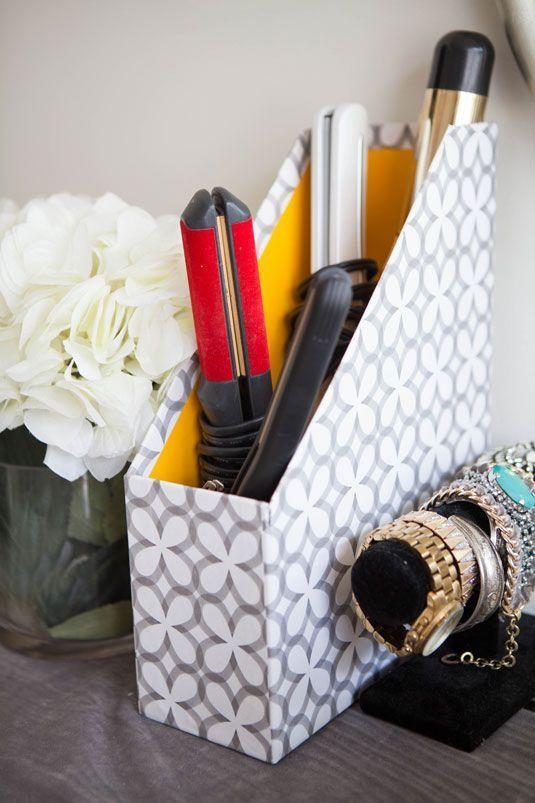 """<p>Corral hot tools (once they've cooled!) on a vanity with a decorative magazine holder.</p><p><a class=""""link rapid-noclick-resp"""" href=""""https://www.amazon.com/Evelots-Magazine-Holder-Organizer-Full-Wide-White-Labels-Set/dp/B01E5RKHTC?tag=syn-yahoo-20&ascsubtag=%5Bartid%7C2164.g.35037072%5Bsrc%7Cyahoo-us"""" rel=""""nofollow noopener"""" target=""""_blank"""" data-ylk=""""slk:SHOP MAGAZINE HOLDERS"""">SHOP MAGAZINE HOLDERS</a> </p>"""