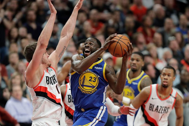 Golden State Warriors forward Draymond Green (23) shoots against Portland Trail Blazers forward Meyers Leonard, left, during the first half of Game 3 of the NBA basketball playoffs Western Conference finals, Saturday, May 18, 2019, in Portland, Ore. (AP Photo/Ted S. Warren)