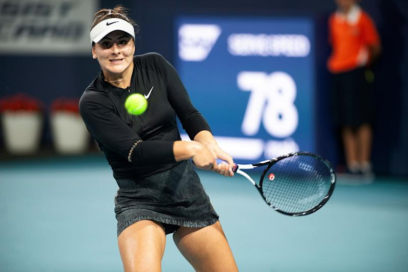 Bianca Andreescu, of Canada, returns a shot to Angelique Kerber, of Germany, during the Miami Open tennis tournament Sunday, March 24, 2019, in Miami Gardens, Fla. (AP Photo/Gaston De Cardenas)